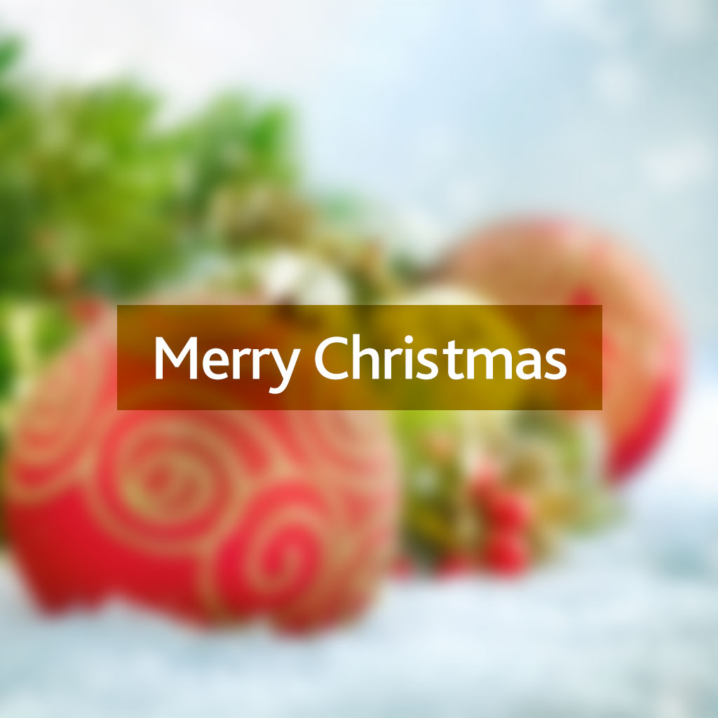 Merry Christmas message on a blurred Christmas bauble background