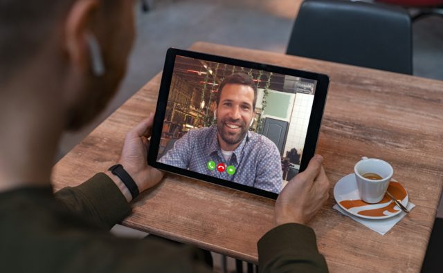 Man doing video call on tablet